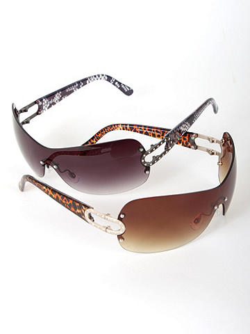 Fierce-n-Frameless Sunglass - Take cover from the sun—while practically GOING undercover in this supremely oversized sunglass. Spy-inspired, the frameless style provides the ultimate in facial protection from the sun's aging rays. Animal-print ear stems feature rhinestone-encrusted oval cutouts, taking chic totally over the top. Imported.
