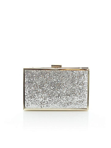 Silver Sparkle Clutch - Don't let your outfit have all the glittering fun! This elegant hardsided clutch features all over shimmer with a silvertone frame shines with stylish chic. Clasp closure at the top. Imported.
