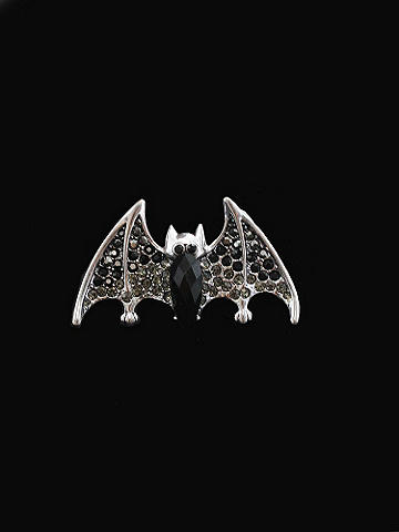 Rhinestone Bat Ring - Fall goes edgy with accessories. Top off your masquerade costume, or add a punch to clubwear and concert get-ups. Bat ring is inlaid with rhinestones. Imported.
