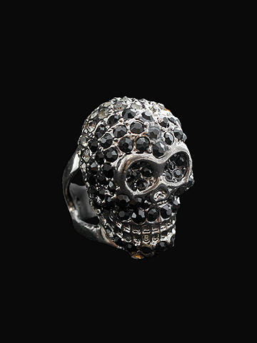 Crystal Skull Ring - Fall goes edgy with accessories. Top off your masquerade costume, or add a punch to clubwear and concert get-ups. Skull ring is inlaid with crystals. Imported.