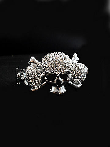 Rhinestone Skull Bangle - Fall goes edgy with accessories. Top off your masquerade costume, or add a punch to clubwear and concert get-ups. Skull bangle is inlaid with rhinestones. Imported.