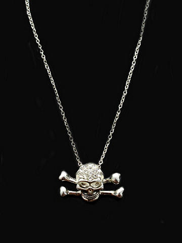 Rhinestone Skull Necklace - A fierce way to glam up your Halloween costume or add sparkle to concert tees and jeans. Skull necklace is accented with rhinestones. Imported.