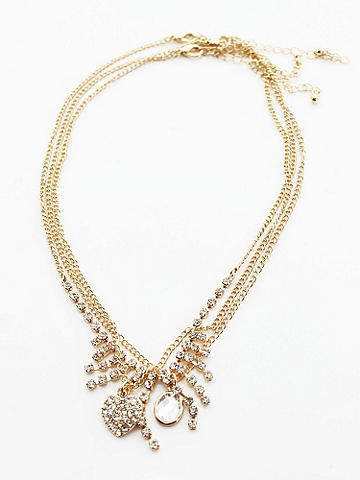 Triple Strand Variety Necklace - Finish your look with glimmering charm. Our Triple Strand Variety Necklace lends any outfit a colorful taste of beauty. Imported.