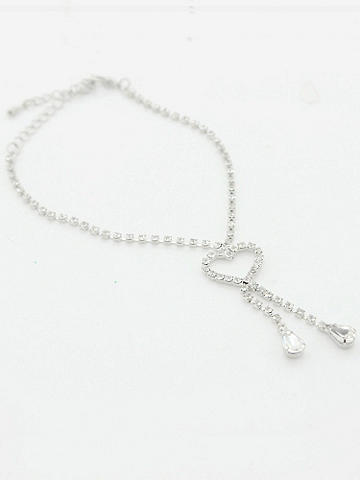Crystal Heart Anklet - It's time to treat your feet with chic. Finish off your head-to-toe glamour with a silver Crystal Heart Anklet. Accented with dangling teardrops. Hook clasp closure. Imported.
