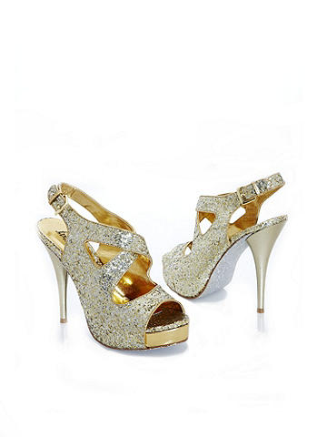 "Crisscross Glitter Stiletto - Because you're a golden girl--from head to toe. This glittering, glam footnote sparkles in a crisscross design. With buckle ankle strap, 1"" platform and 4 1/2"" stiletto heel. Imported."