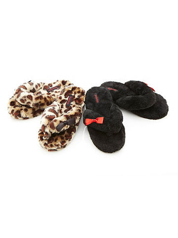 "Plush Perfection Slipper - The most luxurious way to lounge? Slip on this oh-so-soft furry slipper! With non-slip, 1 1/2"" rubber sole. Finished with a flirty bow detail. Imported."