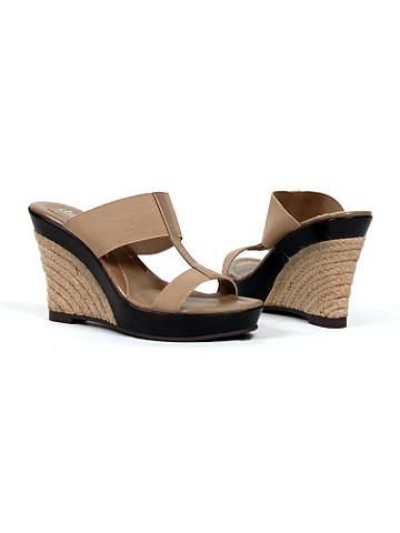 "Slip On Wedge by Charles David - Slip on a little style. Elastic bands conform to createa cute, well-fitting and comfortable heel. Finished with a braided raffia wedge. 2"" heel. From Charles David. Imported. Suggested retail: $90"