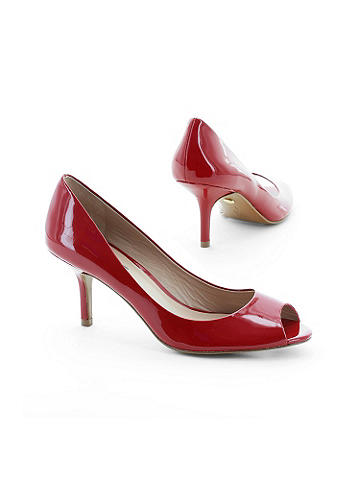 Kitten Heel Pump by Charles David - Charles by Charles David. A peep-toe and shiny patent finish--this is the kitten re-imagined with a modern polish. Featuring a comfortable and wearable design, wear this heel and be chic all day! Imported.