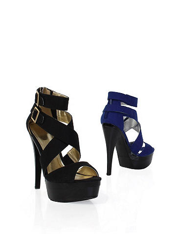 Satin Buckle Platform Heel - Slip into trendsetting chic this season! Satin heels featuring a double buckle ankle straps, platform heel and a crisscross vamp. In short, simply perfect for the parties ahead. Imported.