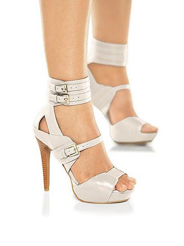 Multi-Buckle Stiletto - Slip into trendsetting chic this season! Stunning heels featuring a double buckle ankle straps, platform heel and scene-stealing silhouette. In short, simply perfect for the parties ahead. Imported.