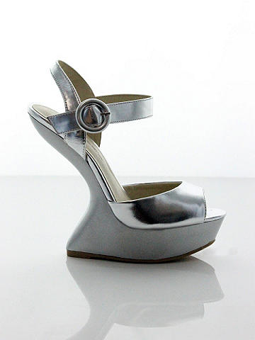 "Daniela Curved Heel Sandal - Put your sexiest foot forward this season in a cutting-edge, high-shine sandal. Open-toe, heelless design features an ankle strap with buckle detail. 2"" platform and 3½"" heel. Imported."