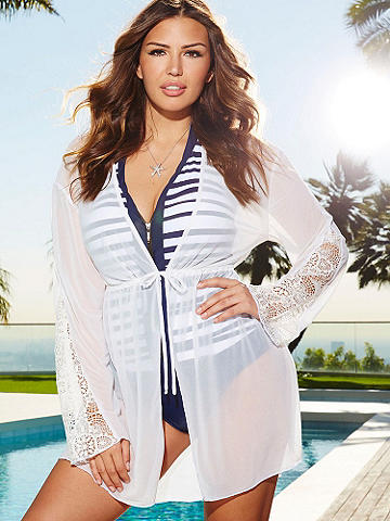 Summer Sheer Cover-Up PLUS - The perfect piece to take along on vacation or throw on over your bikini. This breezy, sheer cover up is designed with an open front and ties at the middle.