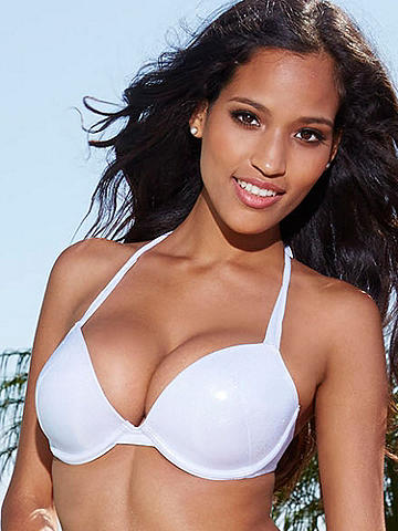 Bombshell Bride Bikini Top - Set sail for the hottest honeymoon ever. This ultra-sexy bikini top was designed with the bombshell bride in mind. Crafted in a shimmering, white-silver fabric, this special style features lightly padded underwire cups for a boost, and string ties at the back and neck. Pair it with our matching Bombshell Bride Bikini Bottom. Polyester. Imported.