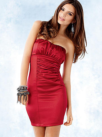"Strapless Satin Present Dress - Sleek and tailored with a sexy surprise, this satin dress is the definition of ""day to night."" For day, finish with a fitted blazer and let front ruching and a lined, lightly padded bust create classic elegance. For evening, expose an enticing open back with zipper closure and beguiling bow detail. Polyester/spandex. USA."