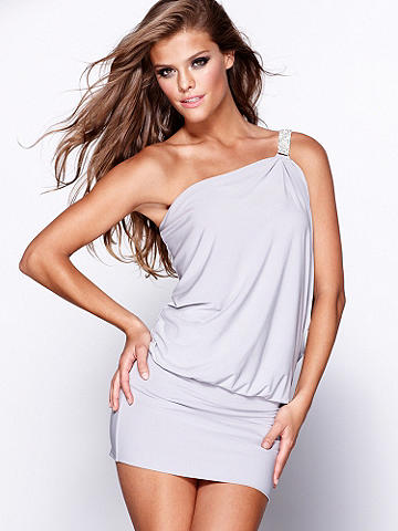Bejeweled Band of Angels Dress - Delicately draped on top and seductively snug on bottom, this knit frock is a knockout combination of opposites. One-shoulder style shines with a radiant rhinestone strap, creating a stunning dress that can be accessorized in either direction from polished to party girl. Polyester/spandex. USA.
