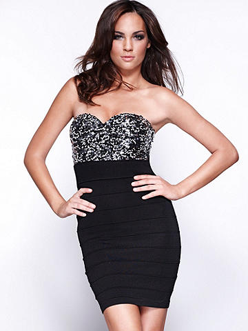 Sequin Bandage Dress - Make shimmer and a body-con fit your evening's signature. Featuring an all over sequined bodice that leads to a banded, bandage-inspired bottom, this is the mini dress to do it in! Lined, padded bust. Sweetheart neckline. Imported.