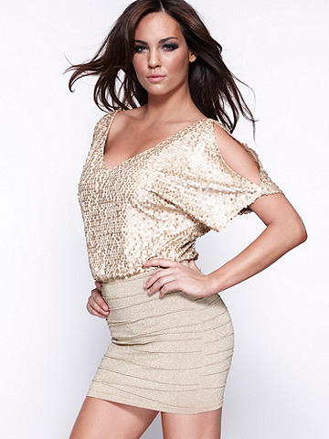 Sequin Cutout Dress - This twofer style dress features a sequined top with cold shoulders and deep plunge. The knit bandage-style skirt has subtle shimmer and a body-hugging fit that perfectly offsets the blouson top. Wear with wedges for day and towering booties at night! Imported.