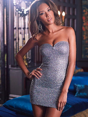 Sweetheart Sequin Dress - Every woman needs a short, sparkling mini! From the sweetheart neckline to the glimmering sequins, this dress is ready for Saturday nights, soirees or whatever your social calendar has in store. Try it with strappy heels and bold lips for the ultimate evening look. Lightly padded at the bodice for a body-flattering fit. Imported.