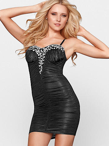 BEADED SWEETHEART DRESS - A dress designed for the spotlight! Featuring a body-hugging, ruched silhouette with metallic beading at the sweetheart neckline. Padded cups add a boost at the bodice. Adjustable spaghetti straps. Slip on a pair of stacked stilettos and let the admiring glances begin! Imported.