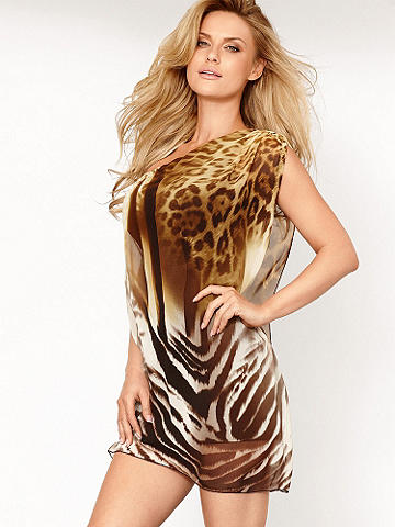 One-Shoulder Kimono Sleeve Dress  - Get vacation ready in this boldly patterned mini dress! In a Grecian-inspired one-shoulder silhouette with stunningly draped single sleeve, this dress makes a luxe and lasting impression. Pair with our Caged Stiletto Sandal for the ultimate getaway package. Polyester/spandex. USA.