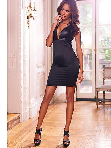 Faux Leather & Satin Dress - Add a touch of bombshell to your nights—it's simple with this body-hugging sheath! Featuring faux-leather and stretch satin X-back dress. Deep plunge V-neck. Add a statement necklace and a simple pump for a night like no other! Polyurethane/polyester/spandex. Imported.