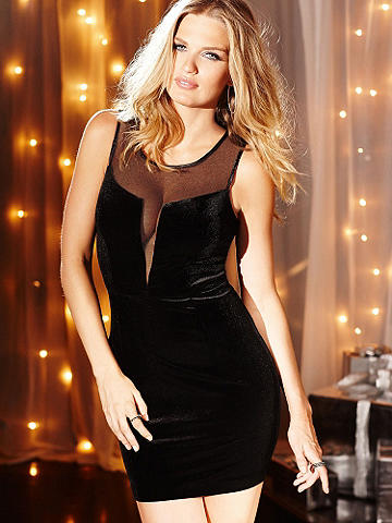 Deep-V Mesh Illusion Dress - A holiday party frock star that's all about stealing the spotlight. This hot little number in curve-loving stretch velvet gets a racy dash of glamour with plunge illusion detail in the front. Illusion back with zipper and button closure. Polyester/spandex. Imported.