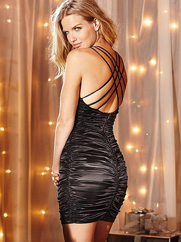Multi-Strap Shirred Dress - Baby, it may be cold outside, but inside the nightlife is hot! Party like the stars on New Year's Eve in a sleek satin sheath and send 2013 out with a bang. This curve- and cleavage-flaunting number is designed with allover ruching and seductive strappy detail in back. Polyester. Imported.
