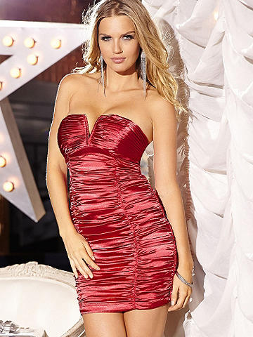Red Hot Satin Mini Dress - The dress that guarantees you'll get in the door at all your New Year's Eve parties. The red hot, little number is designed in the most lustrous satin and allover ruching the hugs your body with shining beauty. Finished with alluring V-neckline. Polish off your look with rhinestones and a strappy silver stiletto. Polyester/spandex. Imported.