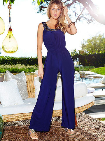 Bejeweled Jumpsuit - An effortlessly sexy look that goes from cocktails to clubbing with ease. Designed in a body-flattering fabric with chic jeweled detail, alluring scoop neckline and ties in back. Polyester/spandex. Imported.