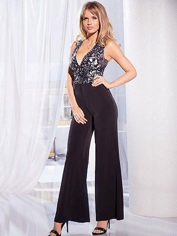 Plunging Neck Jumpsuit - The all-in-one silhouette that never goes out of style! This iteration of the jumpsuit is ready for cocktail hour with metallic heels and a hard sided clutch. And it goes straight to date night with a simple blazer and bold lips. Easy pull-on style designed in a body-draping fabric features an eye-catching silver print at the top. Polyester/spandex. Imported.
