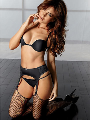 Classic Raw Edge Fishnet Stocking - Classic sex appeal adds a racy edge to everything you wear. Raw edge fishnet stocking has a reinforced toe. Nylon/Lycra®. Imported.