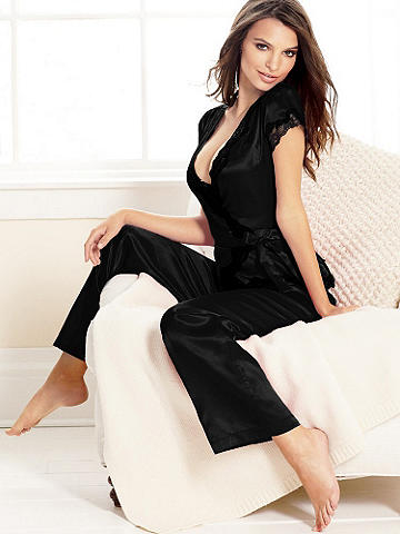 Three-Piece Satin Pajama Set - Our luxe satin three-piece pajama set is the ultimate in luxury. The wrap top is accented with an adjustable tie at the waist and lace-trim at the cap sleeves and neckline. Comes with a matching elastic waist pant and lace-trim short. Polyester. Imported.