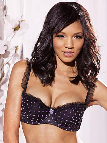 Kira Bra Top - Undress to frill this spring in lingerie made for flirtation. Mesh bra top is adorned with flocked dots and rosette detail. Finished with mesh ruffles at the underwire cups and adjustable straps. Hook-n-eye back. Wear it with our matching Kira Half Slip. Polyester. Imported.