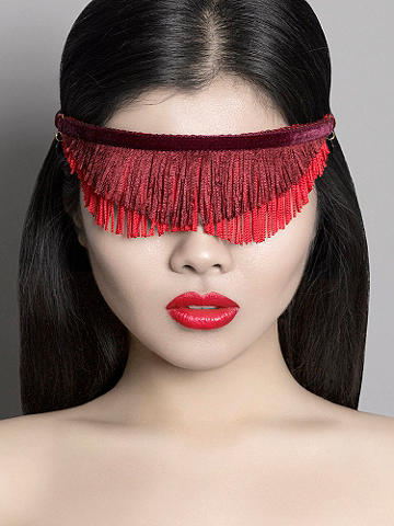 Burgundy & Black Fringe Blindfold - Discover a collection of playful and feminine, luxury accessories. These racy pieces are versatile, strong enough for real play, and can be worn in or out of the bedroom. The fringe blindfold can be worn as a mask, necklace or hair accessory. Features include: