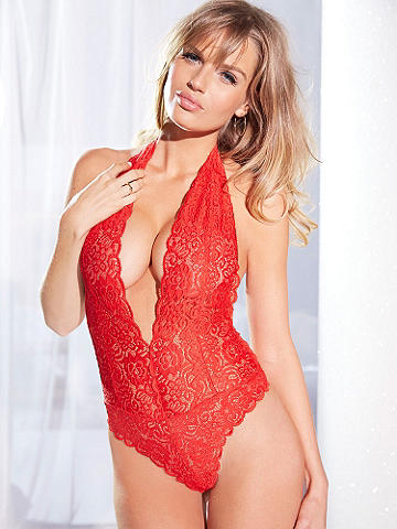 Flirty Floral Lace Teddy - Flirty and feminine floral lace. Irresistible sex appeal. This body-baring teddy brings out your inner bombshell after dark. Designed in the most gorgeous lace, it features: