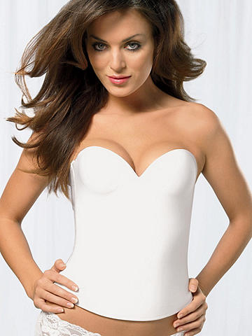 Seamless Bustier - Create curves and slim your shape. This seamless bustier is the perfect shaping garment to wear beneath even the sleekest of styles. Designed in a seamless fabric with light boning on the sides. Hook and eye back closure with four adjustments for a supreme fit. Nylon/spandex. Imported.