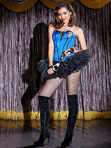 Lace-Up Reversible Corset - Add the figure-enhancing appeal of this reversible corset to your wardrobe. From sexy jailbird to traffic stopper, it features the most incredible details:  <ul>    <li>Reverses from striped to blue</li>    <li>Includes badge</li>    <li>Light boning</li>    <li>Sleek piping</li>    <li>Lace-up front</li>    <li>Hook-n-eye side closures </ul> Polyester. Imported.