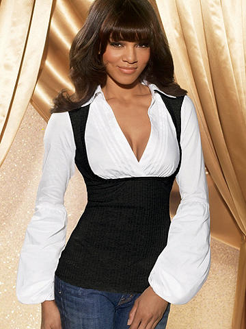Two-Fer Sweater Blouse - Double your sexy style this season. Ribbed poorboy is layered over a collared shirt with surplice pleated neckline and large bubble sleeves. Cotton/polyester/spandex. USA.