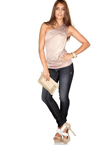 Stretch Jegging - The casual look of jeans with the sexy fit of leggings! Our classic jegging features:<br><br>• Pull-on design<br>• Button closure<br>• Stretch fit<br>• Faux front pockets and functional back pockets<br><br>Cotton/spandex. Imported.<br><br>Wash separately before wearing. Follow the manufacturer's care instructions.<br><br>We want you to love your purchase! Not happy with your selection? We will gladly offer a refund within 90 days of purchase.