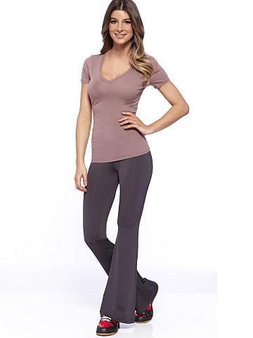 """Long Yoga Pant PLUS - Studio, gym or lounge: slip into comfort and fashion forward style with our all-new yoga pant. Maximize your look with our new V-Neck or Tank Top to ensure you're fabulous, no matter the activity! Be sexy in everyday essentials with star power from Frederick's of Hollywood. <ul>    <li>Curve-hugging bootcut silhouette</li>    <li>Stretch, foldover waist</li>    <li>Ruched detail at back</li>    <li>33"""" inseam</li>    <li>Made in USA</li> </ul> Polyester/spandex."""
