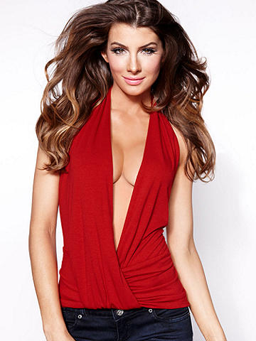 Deep-V Halter Top - Sleek and body baring, this halter flatters with an extremely low neckline and entirely open back. But be warned: Once you slip into this soft, comfy fabric, you'll wonder why you only bought one! Polyester/rayon/spandex. USA.
