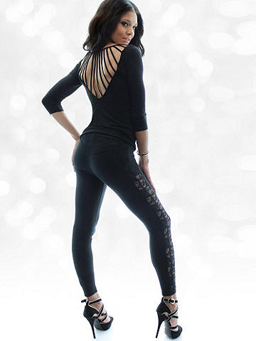 Luxe Lace Legging - The essential legging goes seductive and luxe with beautiful lace insets in back. Layer with knee-high boots and your favorite jacket this winter. Finished with elastic waist. Polyester/rayon/spandex. Imported.