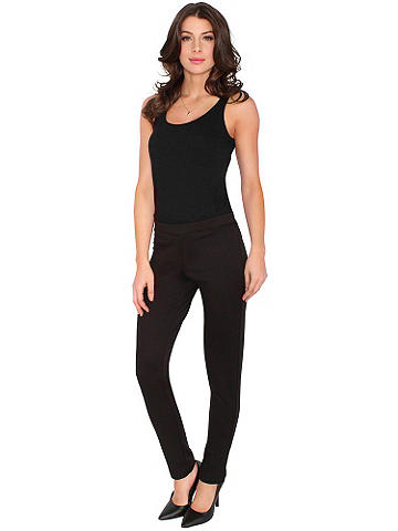 Essential Legging - All-day comfort and style enhance this must-have legging that pairs with sweaters, tunics and mini dresses. Easy slip-on style with elastic band waist. Polyester/rayon/spandex. Imported.