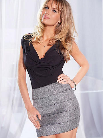 Silver Bandage Mini Skirt - An after-dark must-have for the girl who loves to shine. This pull-on style is designed in silver Lurex elastic bands that hug your curves in the sexiest way. Polyester/spandex. Imported.