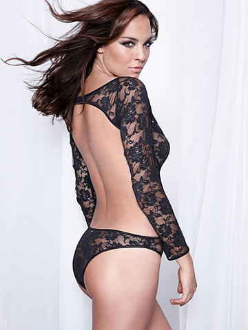 Floral Lace Bodysuit - Nothing's more beautiful than curves encased in lace! Fortunately our bodysuit features floral lace in a long-sleeve, pull-on silhouette. Open at sides and back with bikini panty coverage. Nylon/spandex. Imported.