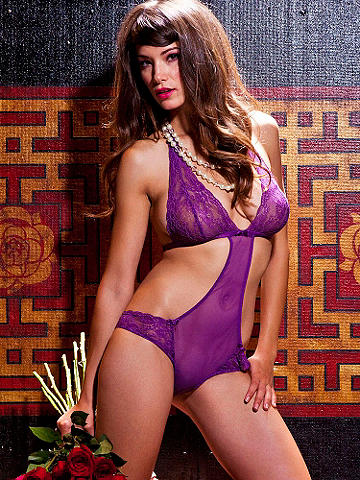 Fishnet Cutout Teddy - The sexiest dare-to-bare style of the season! Flaunt your curves with its body-loving cut. Its gorgeous details include:  Sheer fishnet front panel. Lace halter cups, bow accents. Back hook closure. Imported.