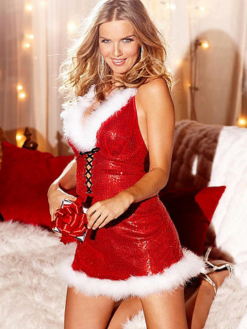 Sequin & Marabou Halter Chemise - This is how Hollywood hotties show their holiday cheer. Go for bombshell, body-hugging style in a shimmering sequin chemise. All dressed up with marabou trim at the neckline and hem. Finished with sexy lace-up detail in front. Polyester/spandex. Imported.
