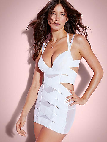 Elena Banded Chemise - Our best-selling Seduction chemise is back and sexier than ever. Classic bandage style designed with thick elastic bands that slim and contour your body. Sexy features include:  <ul>    <li>Halter straps</li>    <li>Mesh panels</li>    <li>Detachable/adjustable garters</li>    <li>Underwire cups</li>     <li>Hook-n-eye back</li> </ul> Nylon/spandex. Imported.