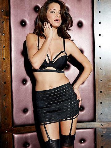 Banded Bra & Gartered Half Slip Set - Ultra-sexy lingerie with a European allure, made for your most seductive nights. Features include:  <ul>    <li>Banded bra with strappy detail</li>    <li>Adjustable straps</li>    <li>Back hook-n-eye</li>    <li>Elastic banded skirt with hook-n-eye back</li>    <li>Adjustable garters</li> </ul> Nylon/spandex. Imported.